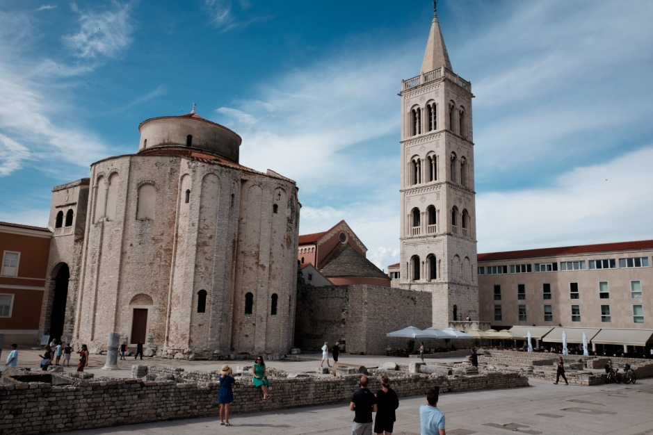 A vast old church in Croatia being visited by many tourists.